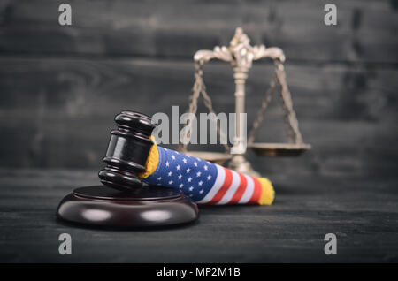 Law and Justice, Legality concept, Judge Gavel, Scales of Justice and United States of America flag on a black wooden background. - Stock Photo