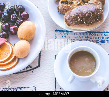 Breakfast including coffee with milk, pastries and fruits. Good morning. Top view. - Stock Photo
