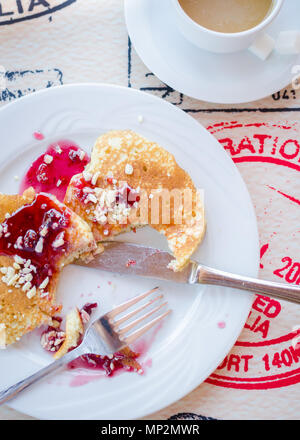 Breakfast including classic pancakes with raspberry jam and coffee with milk. Good morning. Top view. - Stock Photo
