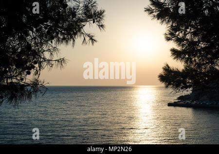 Beautiful sunset view on sea and Stadi Grad - old town of Ulcinj at twilight scene. Coast of Adriatic sea. Montenegro. - Stock Photo
