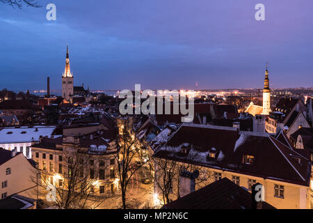 Twilight over the Tallinn old town cityscape with the Saint Olaf church in Estonia capital city. - Stock Photo