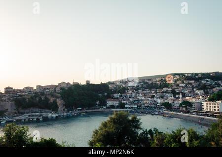 View of city center of Ulcinj, Montenegro. Small beach - Mala Plaza in the evening. - Stock Photo