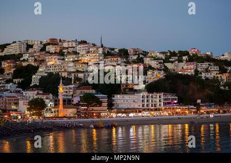 ULCINJ, MONTENEGRO - JULY 28, 2017: Night view of Ulcinj, Montenegro. Small beach - Mala Plaza at night time. - Stock Photo