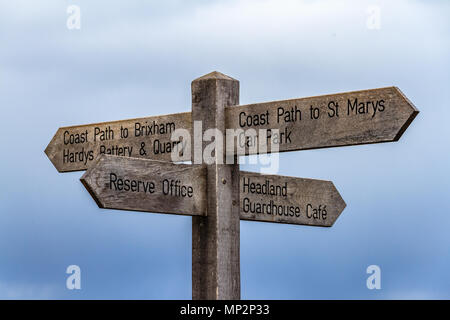 Wooden footpath sign on Berry Head, a nature reserve on a well-known headland near Brixham, Devon, UK. March 2018. - Stock Photo