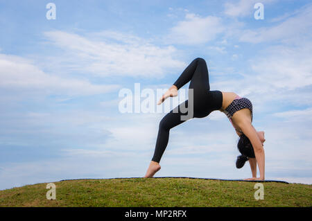 yoga girl In the morning time on blue sky background Strengthen the concentration of skin, health and good health is a good exercise - Stock Photo