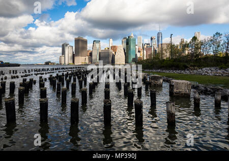 Manhattan skyline as seen from the East River docks in New York City, USA. - Stock Photo