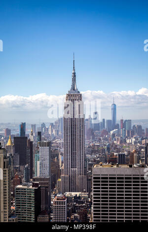 The Empire State building as seen from the Rockefeller Plaza observation deck in New York City, USA. - Stock Photo