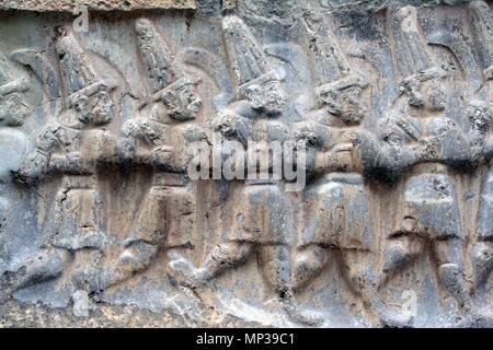 ock-cut relief representing twelve hittite gods in  the archaeological site of Hattusa, ancient city of  Hittiti , Turkey - Stock Photo