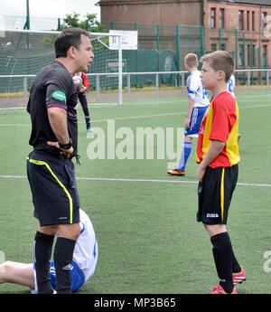 GLASGOW, SCOTLAND - JUNE 8th 2014: A referee has a word with a player about a tackle he made. - Stock Photo