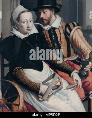A woman at the spinning wheel and a man with a mug seated in an interior *oil on panel *76 × 63 cm *signed b.l.: P *circa 1560 - circa 1570 Man and woman at a spinning wheel, by Pieter Pietersz 993 Pieter Pietersz. (I) 001 - Stock Photo