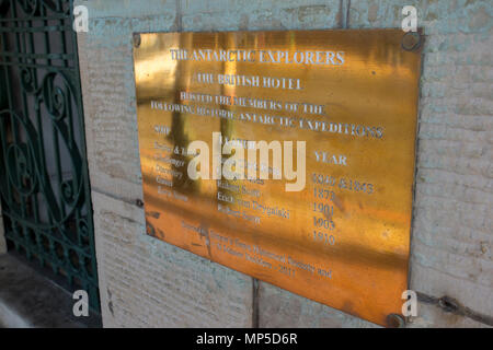 Brass plaque on the wall of The British Hotel in Simon's Town, South Africa, at which many 18th and 19th century Antarctic explorers stayed. - Stock Photo