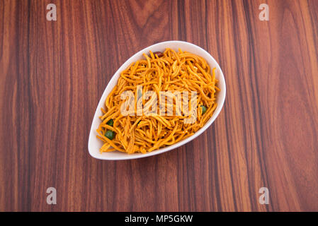 murukku or traditional indian snack chakli and chakali on background - Stock Photo