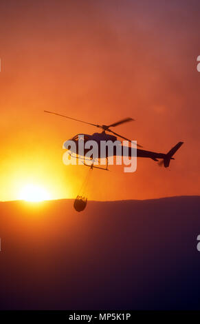 WATERDROPPING HELICOPTER USED DURING SYDNEY BUSH FIRES, NEW SOUTH WALES, AUSTRALIA - Stock Photo