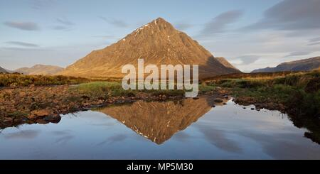 A 2:1 panoramic crop of the iconic view of Buachaille Etive Mor in Glencoe. The shot was taken in the early morning from the banks of the River Etive - Stock Photo