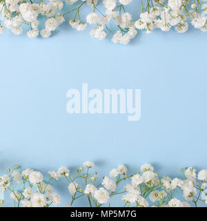 Styled stock photo. Feminine wedding desktop mockup with baby's breath Gypsophila flowers on blue background. Empty space. Floral frame, web banner. Top view. Square icture for blog or social media. - Stock Photo