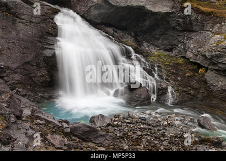Small Waterfall on the river Videdola seen from the Gamle Strynefjellsvegen Route, Norway. - Stock Photo