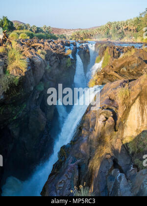View over beautiful scenic Epupa Falls on Kunene River between Angola and Namibia in evening light, Southern Africa - Stock Photo