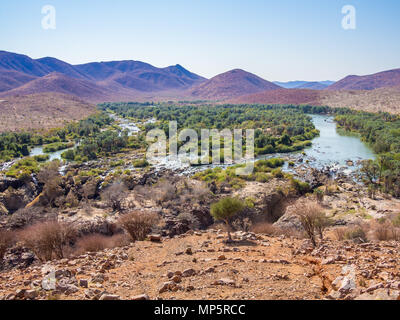 Panoramic view over Kunene River and Epupa Falls at border between Namibia and Angola, Africa - Stock Photo