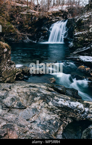 Falls of Falloch Waterfall, Trossachs National Park, Scotland UK in winter - Stock Photo