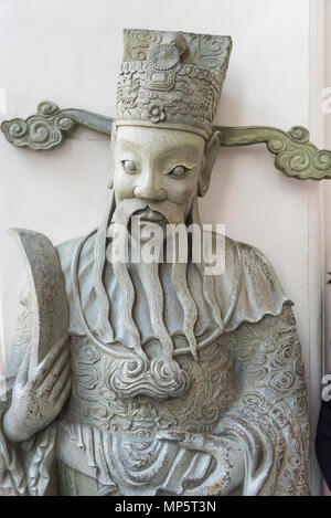 The face of a stone carving in the grounds of the Wat Pho (the Temple of the Reclining Buddha), or Wat Phra Chetuphon Bangkok Thailand - Stock Photo