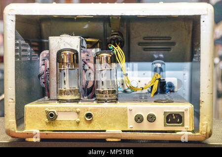 Radio tubes inside the old amplifier. Selective focus - Stock Photo