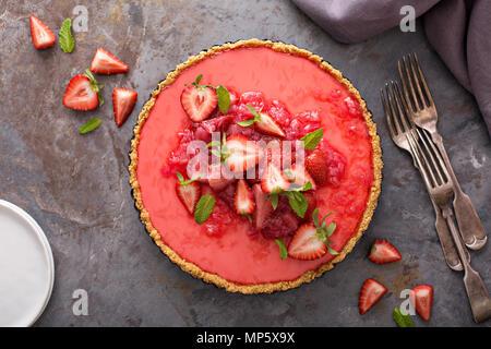 Yogurt tart with rhubarb strawberry compote - Stock Photo