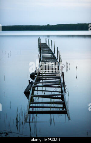 Old wooden jetty on the lake. Old wooden jetty on the lake. - Stock Photo