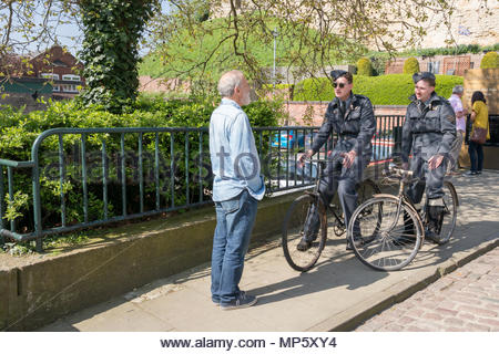 World War II re-enactors speaking to a member of the public in Lincoln town centre, Lincolnshire, UK - Stock Photo