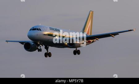 Alitalia Airbus A320 Landing at London Heathrow Airport - Stock Photo