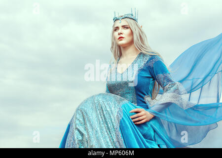 Portrait of a beautiful young woman elf in a blue dress. - Stock Photo