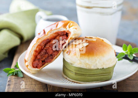 Savory chinese pastries with red bean filling - Stock Photo