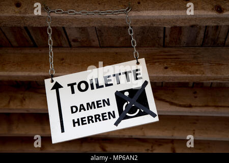 Sign Board Men Women Handicapped.- wheelchair accessible toilet is out of order - Stock Photo