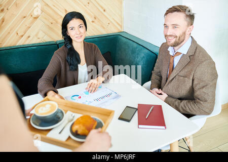 Business People Meeting in Cafe - Stock Photo