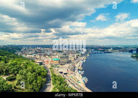 Skyline, Kiev city with beautiful sky. Right bank the Dnieper River. Podil district. Aerial view - Stock Photo