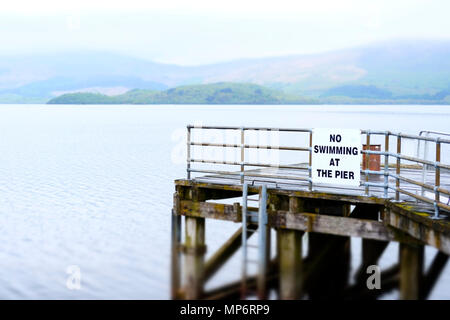 No swimming at pier jetty deep water Loch Lomond Luss warning sign danger of death - Stock Photo