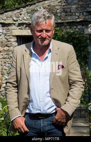London, UK. 21 May 2018. The Welcome to Yorkshire show garden with Garden designer Mark Gregory. Press Day at the 2018 RHS Chelsea Flower Show which opens to the public on tomorrow. Photo: Bettina Strenske/Alamy Live News - Stock Photo