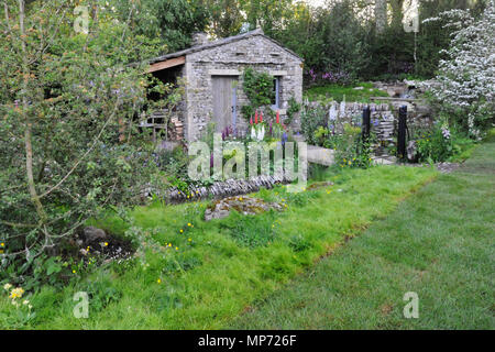London, UK. 21st May 2018. The Welcome to Yorkshire Garden (designed by Mark Gregory), one of the beautiful and elegant show gardens on display at the 2018 RHS Chelsea Flower Show which opened today in the 11-acre grounds of the Royal Hospital Chelsea, London, United Kingdom.   Credit: Michael Preston/Alamy Live News - Stock Photo
