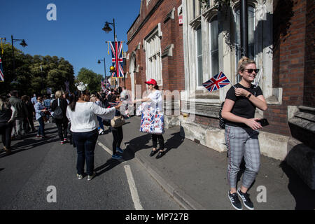 People seen with the union flag. The wedding of Prince Harry and Meghan Markle was held on 19 May 2018 in St George's Chapel at Windsor Castle in the United Kingdom, ordinarily people from UK and  the rest of the world came to celebrate and enjoy the royal wedding. - Stock Photo