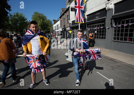 May 19, 2018 - Windsor, United Kingdom - People seen holding the union flags..The wedding of Prince Harry and Meghan Markle was held on 19 May 2018 in St George's Chapel at Windsor Castle in the United Kingdom, ordinarily people from UK and  the rest of the world came to celebrate and enjoy the royal wedding. (Credit Image: © Rahman Hassani/SOPA Images via ZUMA Wire) - Stock Photo