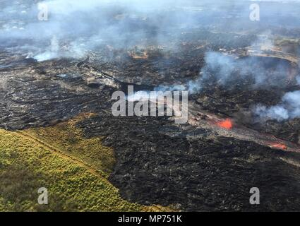 Hawaii, USA. 20th May 2018. Channelized lava streams down fissure 20 into a massive ground crack from the eruption of the Kilauea volcano May 20, 2018 in Pahoa, Hawaii. Credit: Planetpix/Alamy Live News - Stock Photo