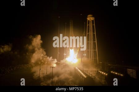 The Orbital ATK Antares rocket, with the Cygnus spacecraft onboard, blasts off from launch Pad-0A, early morning at Wallops Flight Facility May 21, 2018 in Wallops, Virginia. The Antares is carrying the Cygnus spacecraft filled with 7,400 pounds of cargo for the International Space Station on May 21st. - Stock Photo
