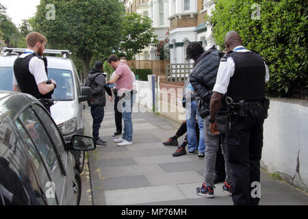 Shepherds Bush, London, UK. 21st May 2018. Police chase and apprehend 3 suspects to stop and search them on the street near westfield on a busy evening.  Credit: Adam Constantine/Alamy Live News - Stock Photo