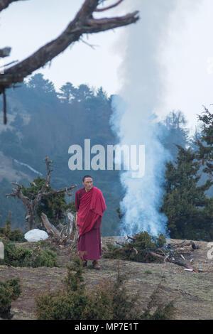 Monks performing a cleansing ritual near Paro, Bhutan - Stock Photo
