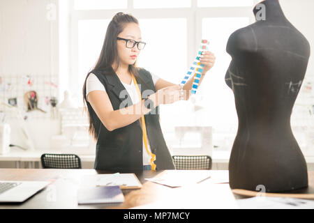 Asian Woman Working in Atelier - Stock Photo
