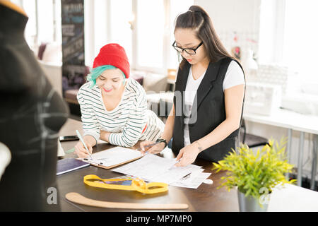 Young Women Working in Atelier Workshop - Stock Photo
