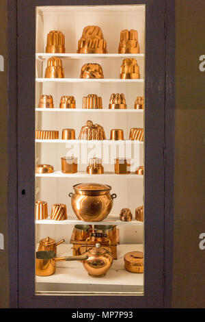 A display of copper moulds and vintage kitchen equipment in the Old Kitchen at Inveraray Castle, Argyll & Bute, Scotland, UK - Stock Photo