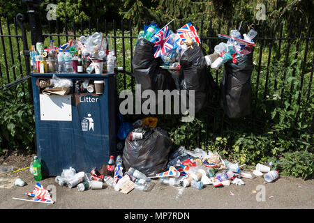 Litter overflowing in plastic dustbin liners and a public litter collection point, Windsor, Berkshire, United Kingdom - Stock Photo
