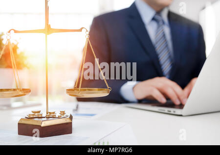 Justice symbol weight scales on table. Attorney working in office. Law attorney court judge justice legal legislation concept - Stock Photo