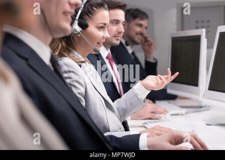 Cropped shot of helpline workers - Stock Photo