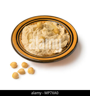 Traditional bowl with Lebanese hummus made from chickpeas isolated on white background - Stock Photo